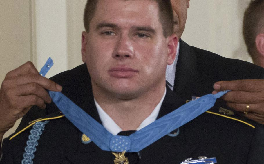 President Barack Obama presents former Army Sgt. Kyle White with the Medal of Honor in a ceremony at the White House on May 13, 2014.