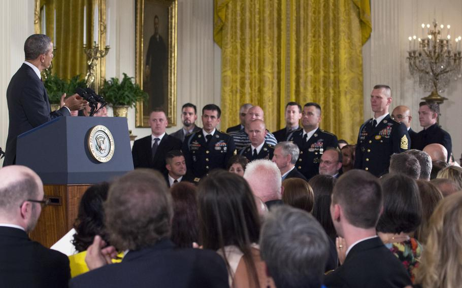 President Barack Obama leads applause for members of the 173rd Airborne Brigade during a ceremony to present former Army Sgt. Kyle White with the Medal of Honor on May 13, 2014.