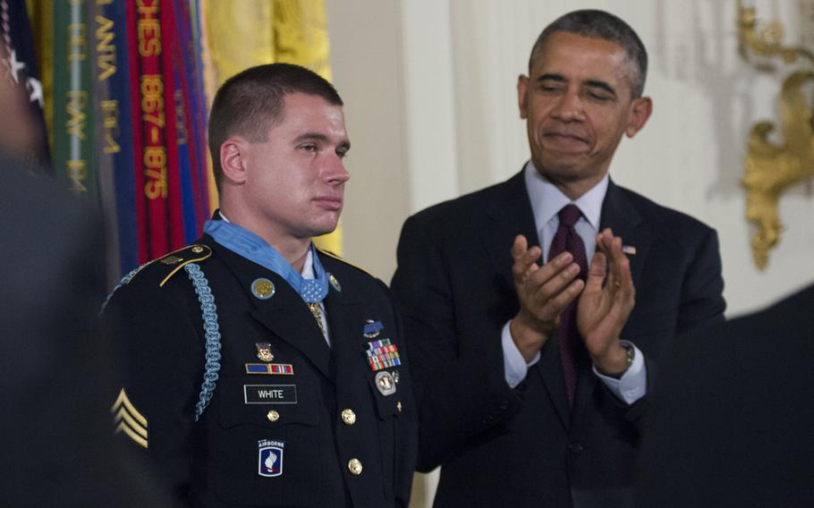President Barack Obama leads applause for former Army Sgt. Kyle White after presenting him with the Medal of Honor at the White House on May 13, 2014.