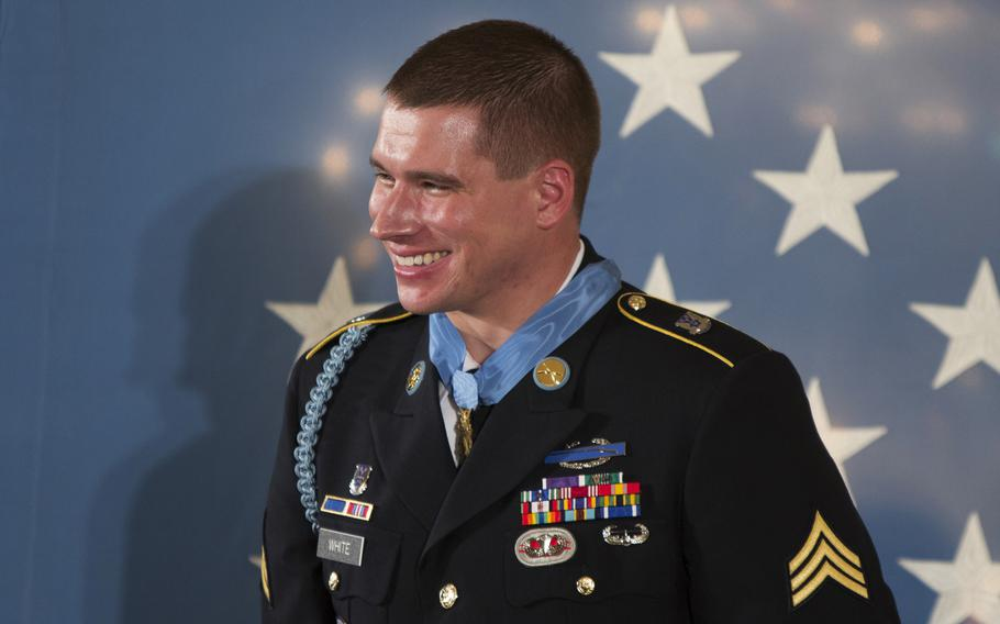 Former Army Sgt. Kyle White smiles after being presented with the Medal of Honor at the White House on May 13, 2014.