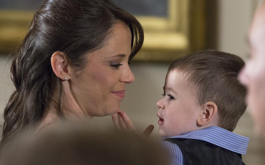 Former Army Staff Sgt. Ryan Pitts's wife Amy and son Lucas at the Medal of Honor ceremony at the White House, July 21, 2014.