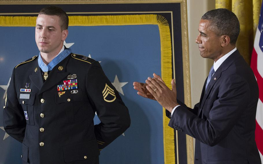 President Barack Obama leads the applause after awarding former Army Staff Sgt. Ryan Pitts the Medal of Honor at the White House, July 21, 2014.