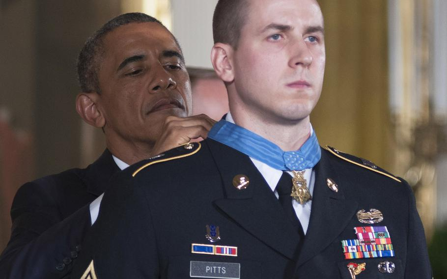 President Barack Obama awards former Army Staff Sgt. Ryan Pitts the Medal of Honor at the White House, July 21, 2014.