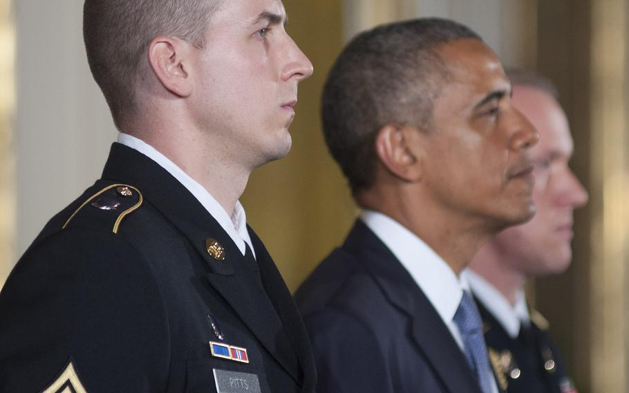 Former Army Staff Sgt. Ryan Pitts and Pesident Barack Obama listen as Pitt's Medal of Honor citation is read during the ceremony for  at the White House, July 21, 2014.