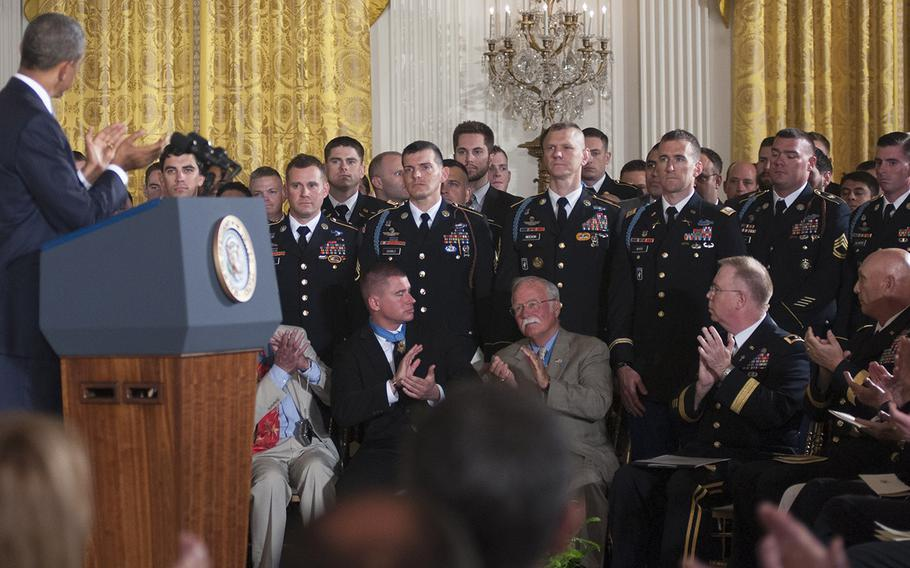 President Barack Obama, Medal of Honor recipients and military leaders applaud as members of former Army Staff Sgt. Ryan Pitts's unit are introduced during the ceremony at the White House, July 21, 2014.
