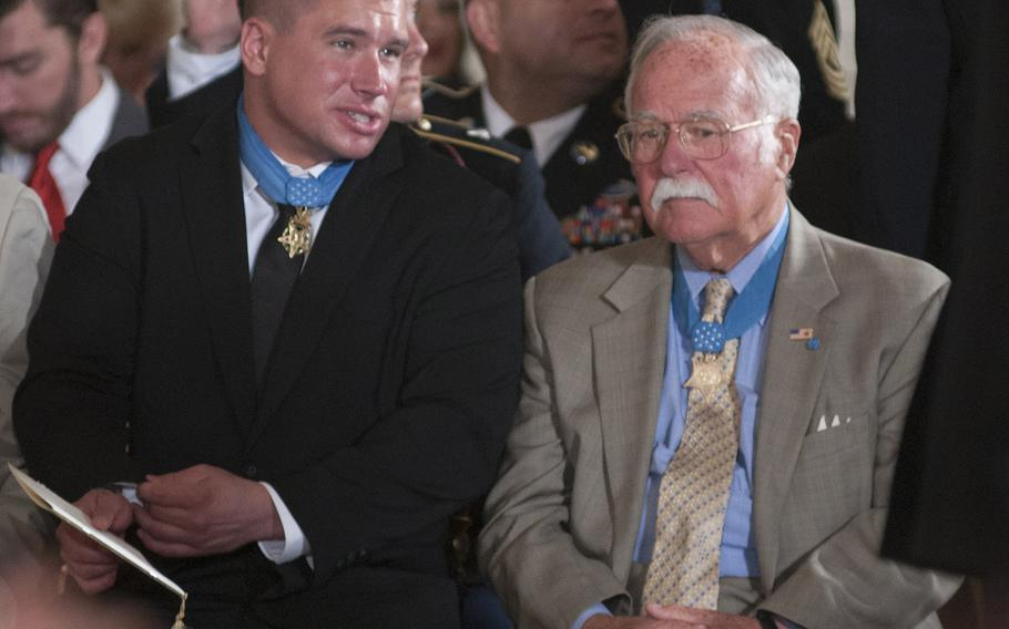 """Medal of Honor recipients Kyle White and Harvey """"Barney"""" Barnum await the start of the ceremony for former Army Staff Sgt. Ryan Pitts at the White House, July 21, 2014."""