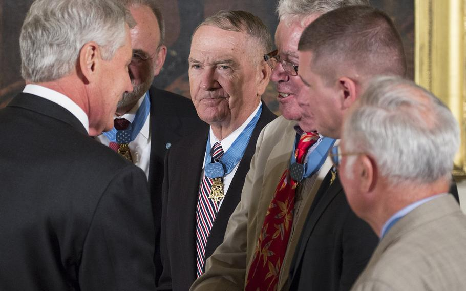 """Secretary of Defense Chuck Hagel talks with Medal of Honor recipients Brian Thacker, Leo Thorsness, Thomas Kelley. Kyle White and Harvey """"Barney"""" Barnum before the ceremony for former Army Staff Sgt. Ryan Pitts at the White House, July 21, 2014."""