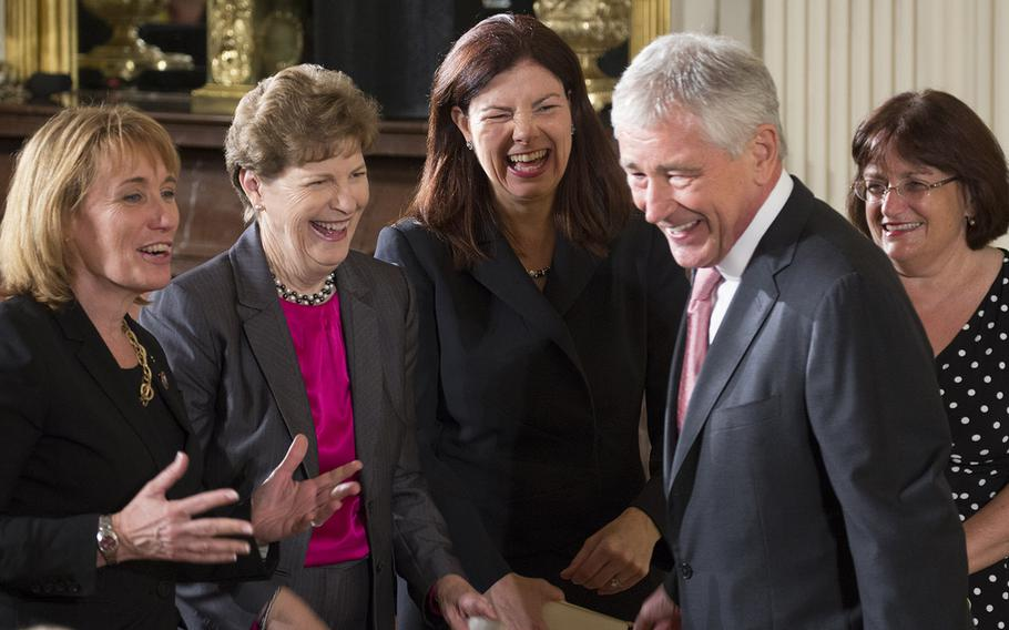 Secretary of Defense Chuck Hagel talks with New Hampshire political leaders, left to right, Gov. Maggie Hassan, Sen. Jean Shaheen, Sen. Kelly Ayotte and Rep. Ann McLane Kuster before the Medal of Honor ceremony for former Army Staff Sgt. Ryan Pitts, a Granite State native, at the White House, July 21, 2014.