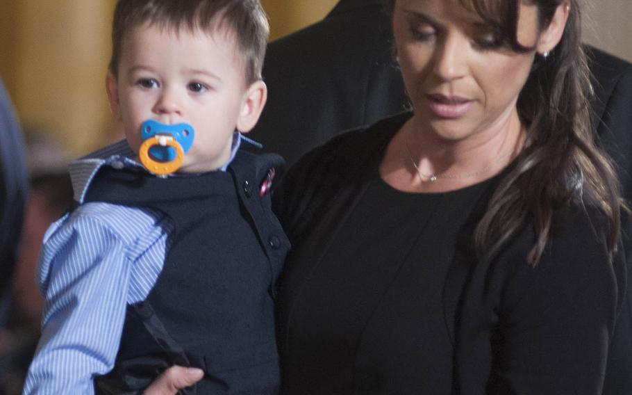 Former Army Staff Sgt. Ryan Pitts' wife Amy and son Lucas arrive for the Medal of Honor ceremony at the White House, July 21, 2014.
