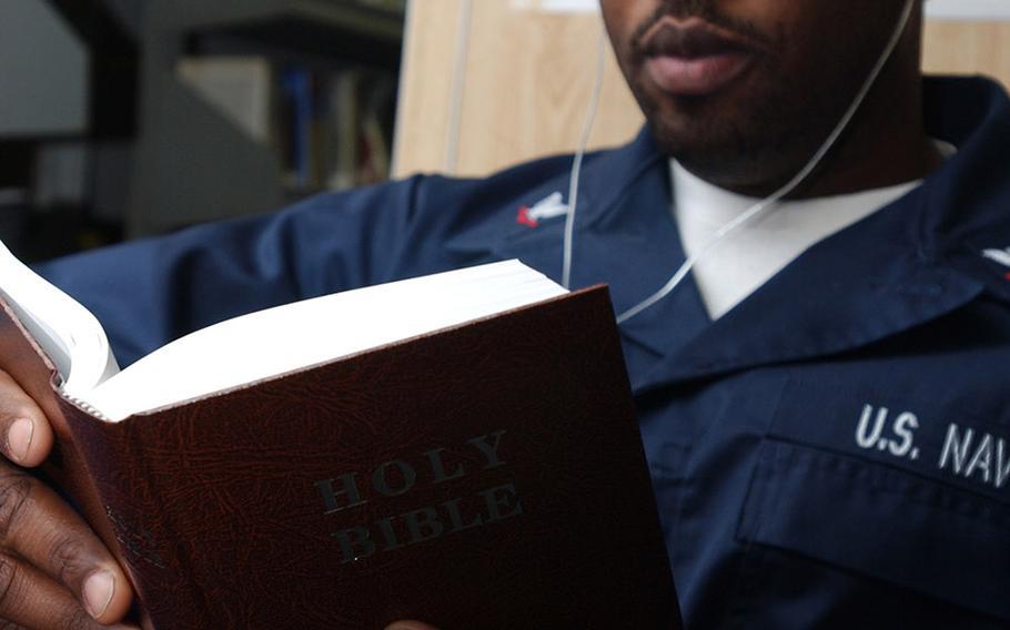 Petty Officer 3rd Class Matthew Smalls reads a bible in 2008.
