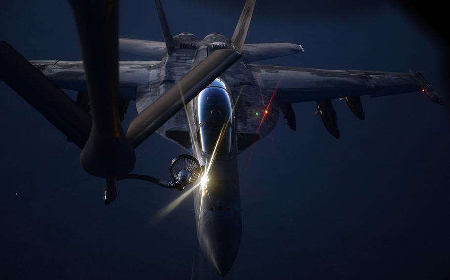 An U.S. fighter jet refuels from an Air Force KC-135 Stratotanker.