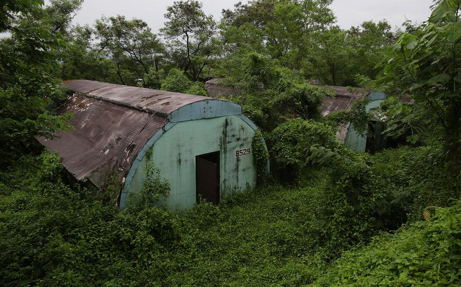 """A row of concrete structures called """"Quonset huts"""" lie inside the Subic Bay Freeport Zone, Zambales province, northern Philippines, on Oct. 18, 2014. The huts were used as barracks for U.S. Marines inside the former American naval base. It was closed in 1992 after the Philippine Senate voted not to extend the lease on the facility. Some of the abandoned huts were reused as dormitories and staff houses for employees. Other abandoned huts have not been touched since U.S. forces left 22 years ago."""