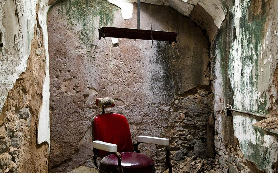 This Oct. 13, 2014, photo shows a barber shop in cellblock 10 at Eastern State Penitentiary in Philadelphia. The penitentiary took in its first inmate in 1829, closed in 1971 and reopened as a museum in 1994.