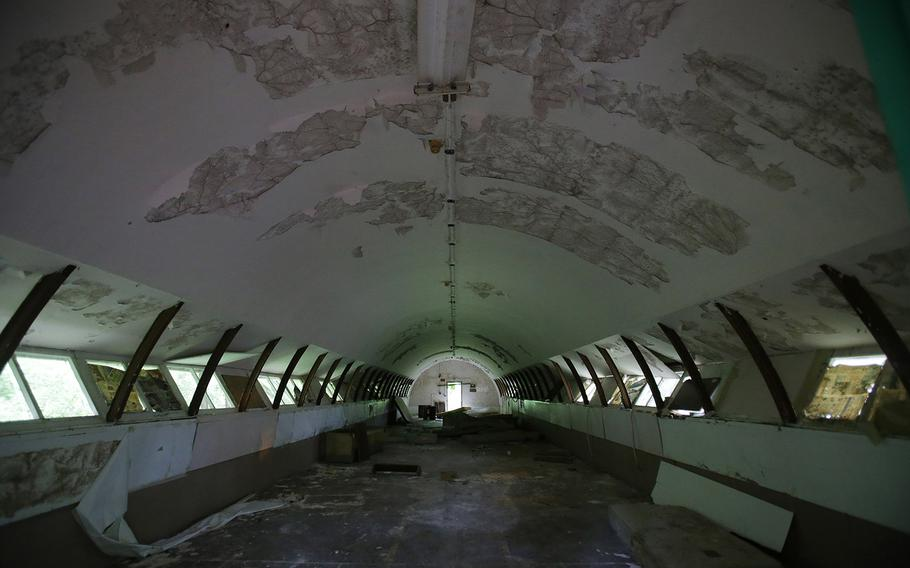 """In this Oct. 18, 2014 photo, the interior of concrete structures called """"Quonset huts"""" crumbles inside the Subic Bay Freeport Zone, Zambales province, northern Philippines. Naval Station Subic Bay used to be one of the largest U.S. military base outside the American mainland. It was partly damaged during the eruption of Mount Pinatubo forcing American troops from the more severely damaged Clark Air Base to relocate at Subic. It was closed in 1992 after the Philippine Senate voted not to extend the lease on the facility."""