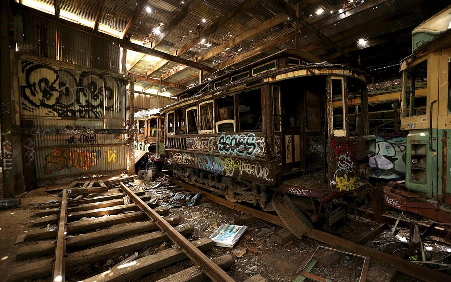 In this Oct. 22, 2014 photo, old tramcars and trolley buses sit abandoned and wrecked in the Loftus Tram Shed in Sydney. Trams became a key part of life in Sydney after the network was installed in 1879, with 1,600 cars in service during the height of its popularity. The service was eventually shut down in 1961.