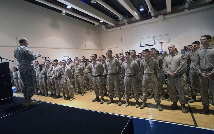 U.S. Chairman of the Joint Chiefs of Staff Army Gen. Martin E. Dempsey talks with approximately 150 U.S. military members during a town hall meeting in Baghdad on Nov. 15, 2014.