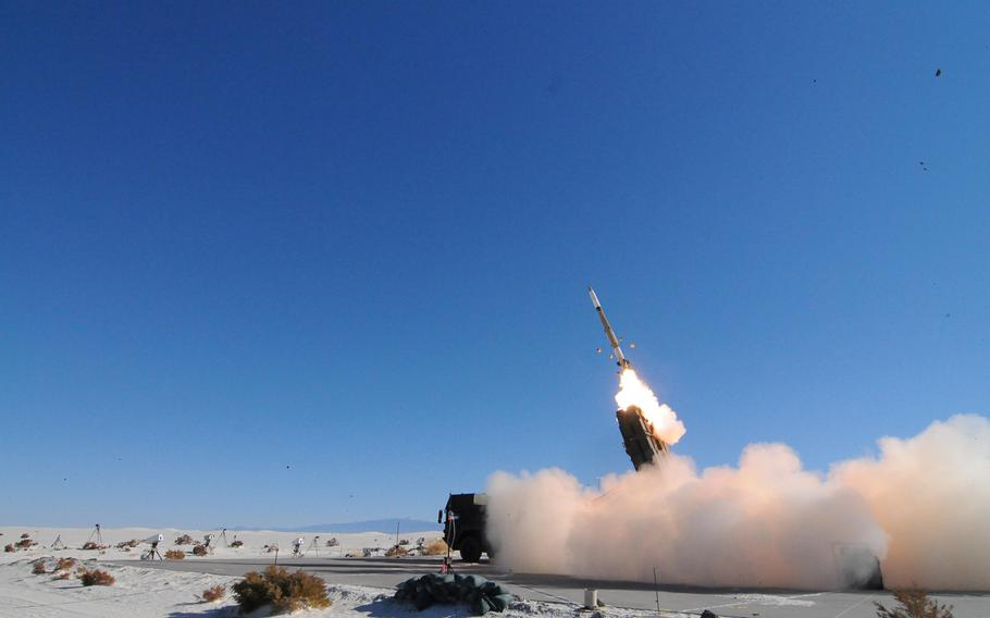 A missile is launched at an airborne target during a test of an air defense system at the Army's White Sands Missile Range, N.M., in November 2013.