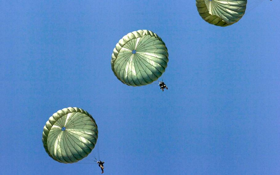 Paratroopers from the 82nd Airborne's 3rd Brigade Combat Team and Division Special Troops Battalion exit an Air Force C-130 during a jump at Fort Bragg's Sicily Drop Zone, July 14, 2010.