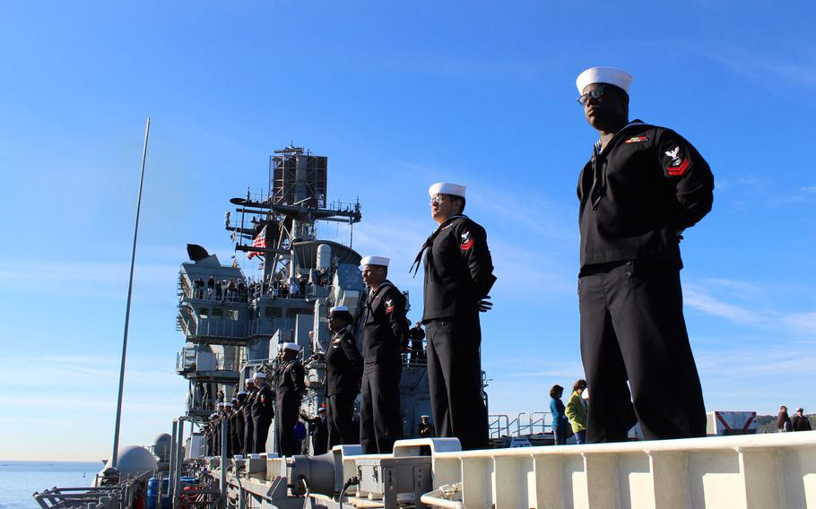 Sailors man the rails on the USS Makin Island as the Wasp-class amphibious assault ship makes its way into San Diego Bay on Wednesday morning. The ship was returning from a seven-month deployment during which the crew remained at sea for a 115-day stretch.