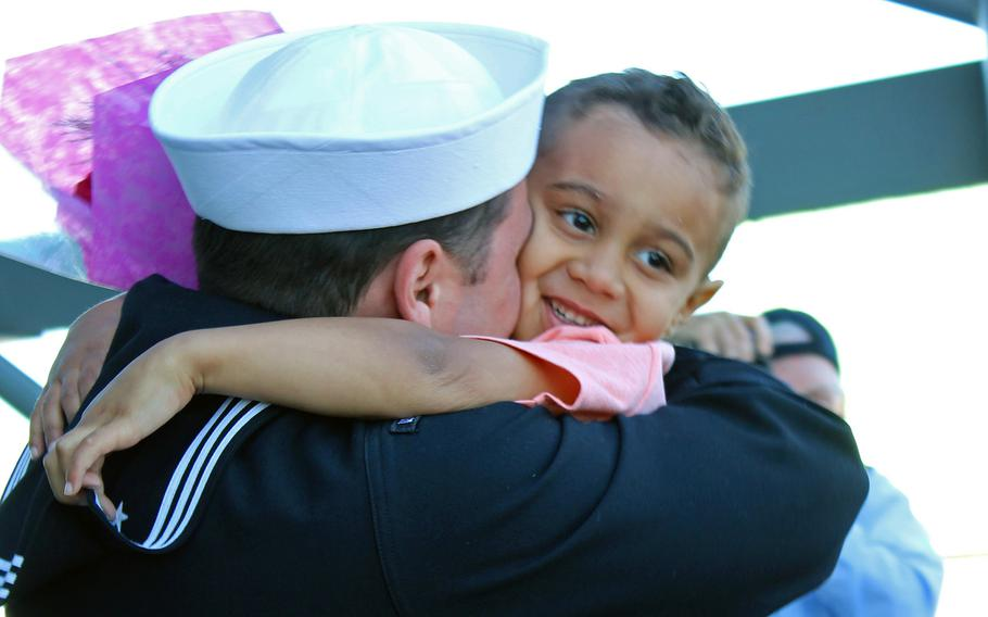 Petty Officer 2nd Class Matthew Granaas hugs his 3-year-old son, Bradley, on Feb. 25, 2015, after Granaas returned to Naval Base San Diego from a seven-month deployment aboard the USS Makin Island.