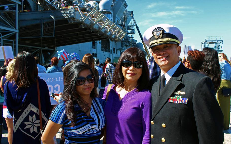Lt. Cmdr. Fabio Austria poses with his daughter, Jiamay, and his wife, Joy, on Feb. 25, 2015, at Naval Base San Diego. Austria returned Wednesday from a seven-month deployment aboard the USS Makin Island.