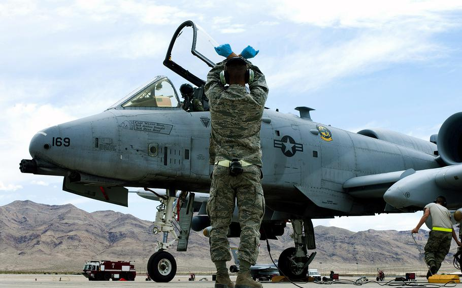 An Air Force crew chief watches as an A-10 Thunderbolt taxis into position after landing May 9, 2013, at Nellis Air Force Base, Nev.
