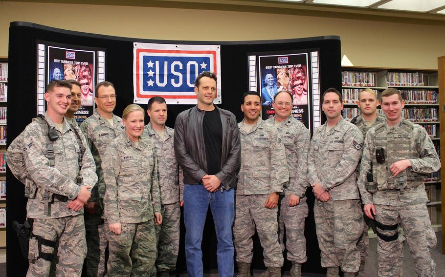 """Actor Vince Vaughn poses for photos with airmen at Edwards Air Force Base, Calif., on Saturday. Vaughn met with about two dozen airmen and introduced an advance screening of his new movie, """"Unfinished Business"""" as part of his third USO tour."""