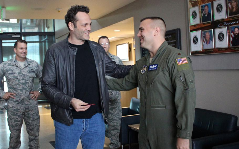 """Actor Vince Vaughn accepts a patch with the Average Joe's logo from Vaughn's movie, """"Dodgeball,"""" from an airman Saturday at Edwards Air Force Base, Calif. Vaughn visited the base as part of a USO tour, his third."""