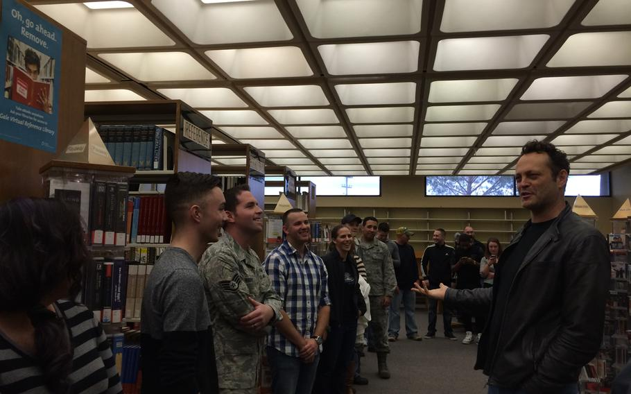 """Actor Vince Vaughn talks to airmen and their families at the Edwards Air Force Base library Saturday, Feb. 28, 2015. Vaughn screened his new movie, """"Unfinished Business on the base as part of his third USO tour."""