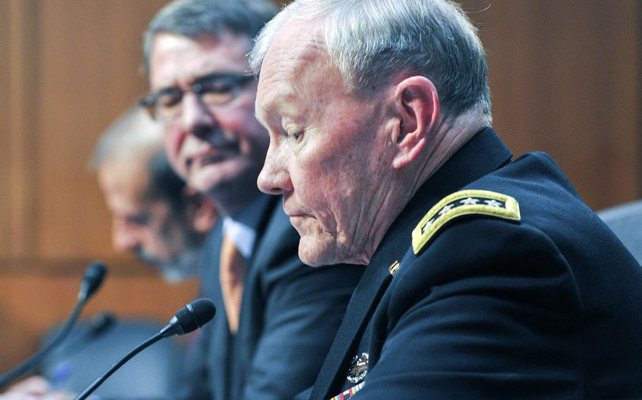 Army Gen. Martin Dempsey testifies before the Senate Armed Forces Committee on Tuesday, March 3, 2015. Looking on is Defense Secretary Ashton Carter.