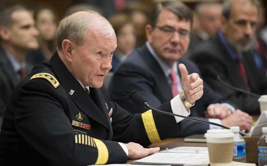 Army Gen. Martin E. Dempsey, chairman of the Joint Chiefs of Staff, testifies as Defense Secretary Ash Carter looks on before the House Armed Services Committee in Washington, D.C., March 18, 2015. The two defense leaders focused on defense programs and combating the Islamic State.