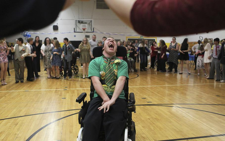 William Marlene, 21, moves across the dance floor on March 17, 2015, during the We Not Me Ball at Enterprise High School in Redding, Calif. Student leaders put on the prom for the special needs students at the school.