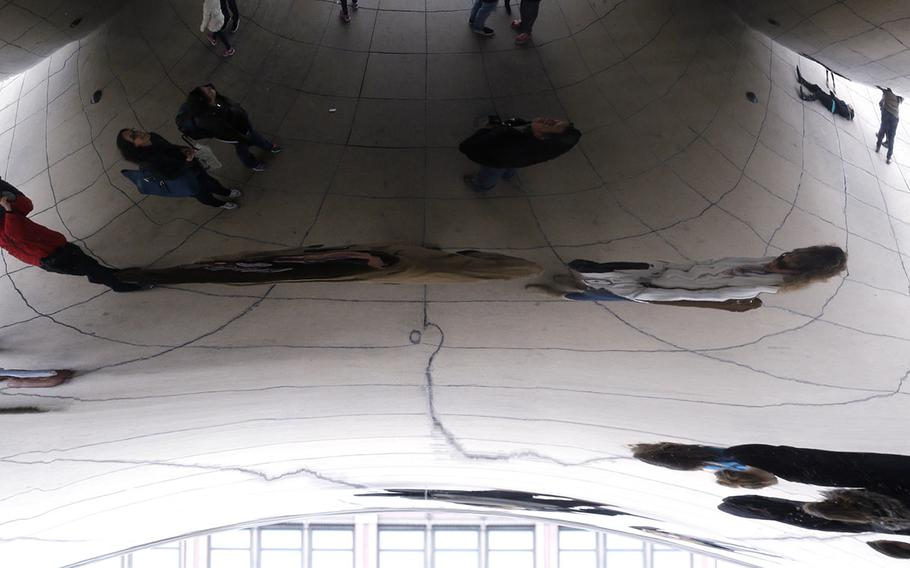 People gather at the Cloud Gate at Millennium Park in Chicago on March 22, 2015.