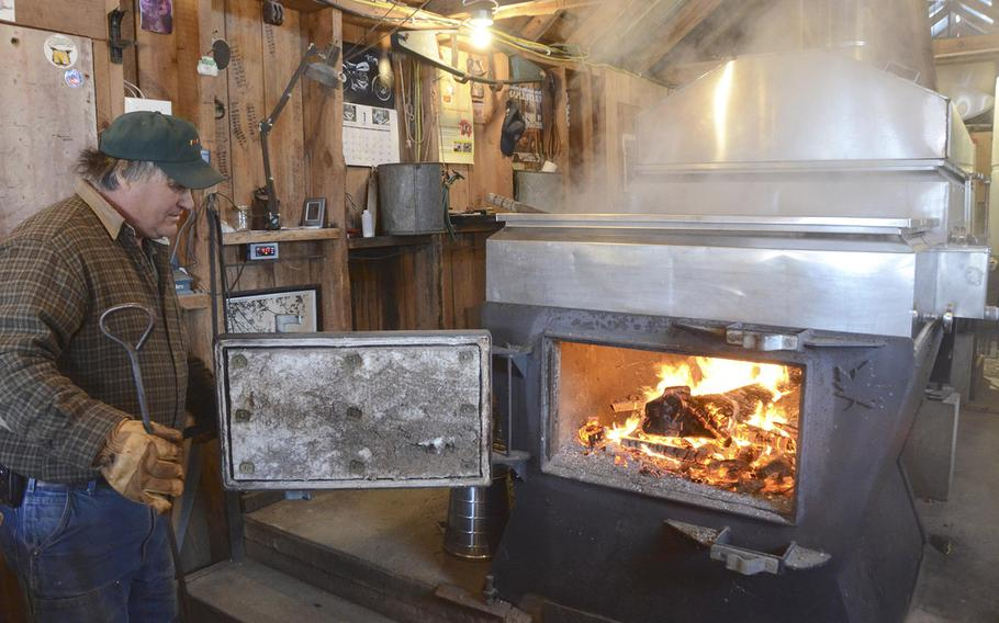 Steve Jennings checks the fire as he boils sap in his sugarhouse on March, 22, 2015, in New Ashford, Mass. To celebrate Massachusetts Maple Weekend, sugarhouses around the state, including Jennings Brook Farm, were open to the public.