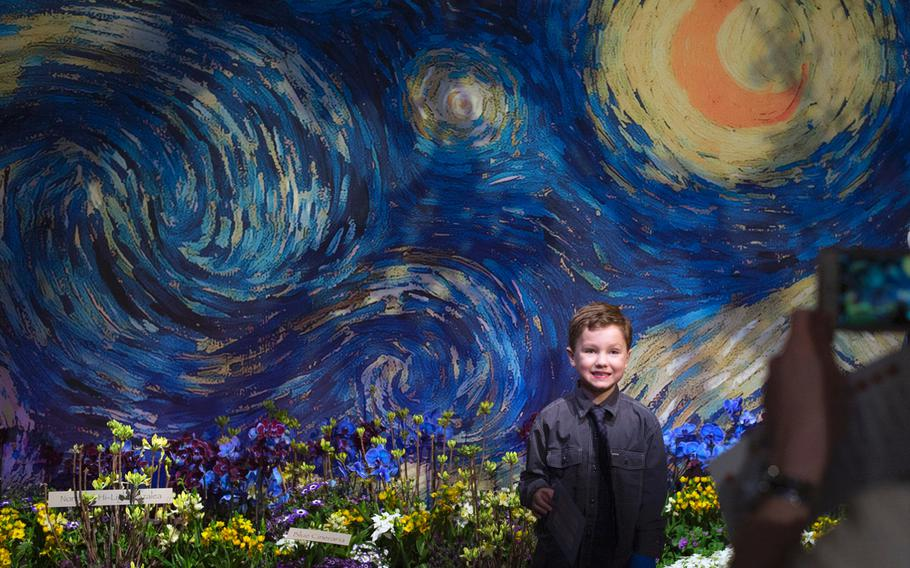 """At the """"Art in Bloom"""" themed Macy's flower show in downtown Minneapolis on March 22, 2015, Payne Serie,6,  had his picture taken in the impressionist garden inspired by Van Gogh ."""