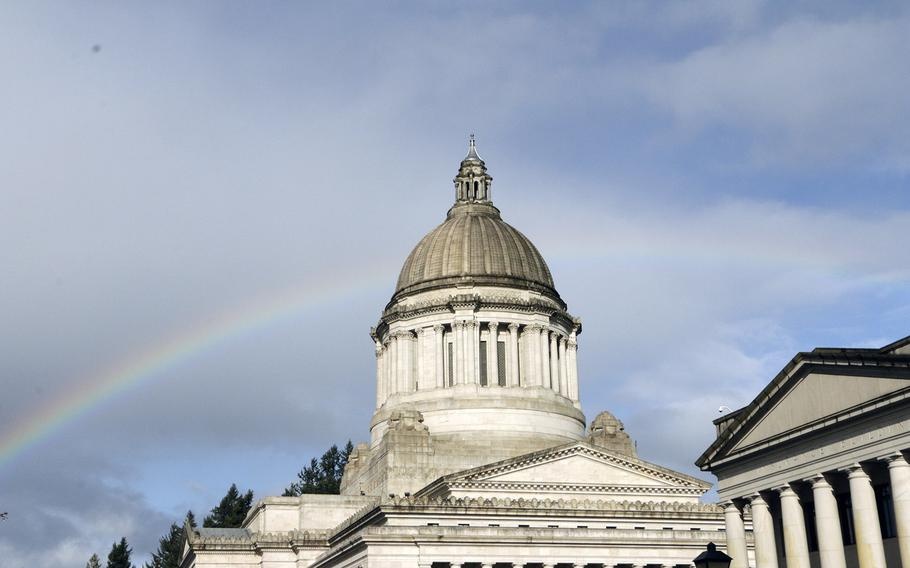 A rainbow is seen behind the Washington state Capitol on March 24, 2015, in Olympia, Wash. Lawmakers are in the middle of a 105-day legislative session.