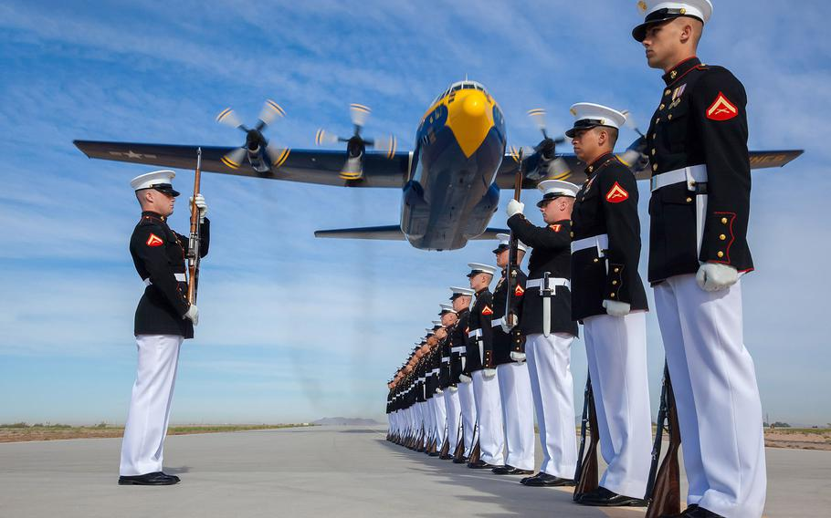 12TH PLACE | A U.S. Marine Corps C-130T Hercules aircraft with the Blue Angels, the Navy's flight demonstration squadron, flies over Marines with the Silent Drill Platoon at Marine Corps Air Station Yuma, Ariz., March 4, 2014.