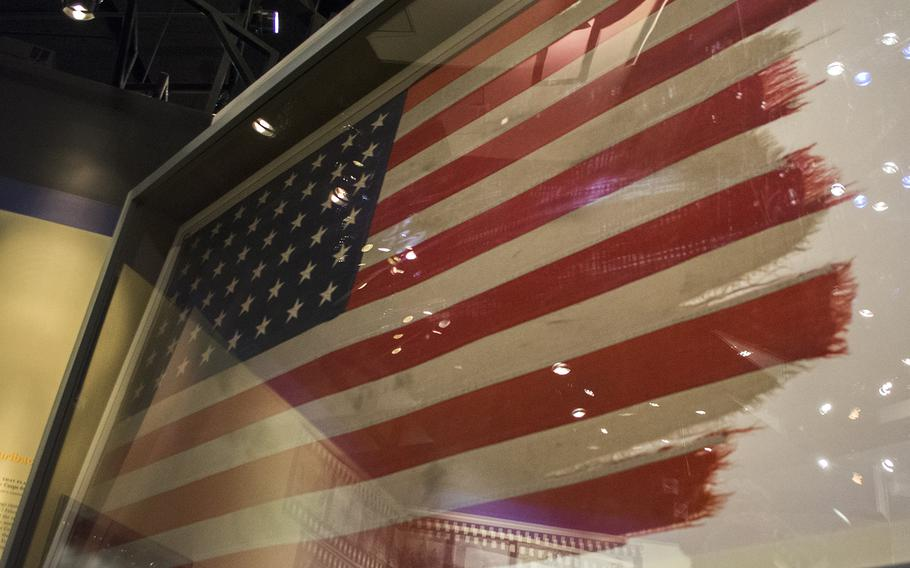 The flag raised on Iwo Jima that was made famous by the Associated Press photographer Joe Rosenthal inside the National Museum of the Marine Corps in Triangle, Va., on Feb. 19, 2015.