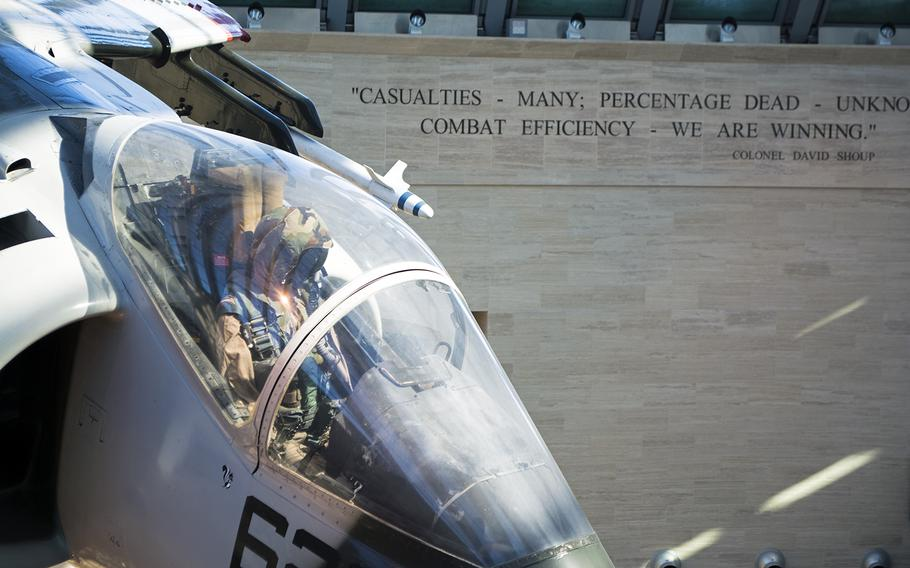 When entering the National Museum of the Marine Corps, visitors first walk into the Leatherneck Gallery, where planes hang from the ceiling and a few large displays rest. Along the edge of the see-through ceiling, are quotes by famous Marines. In this photo from Feb. 19, 2015, snow coats the very edge of the ceiling.