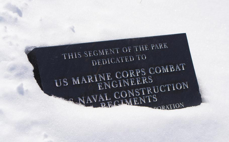 Outside the National Museum of the Marine Corps, in the Semper Fidelis Memorial Park, a sign is partially buried in snow on Feb. 19, 2015.