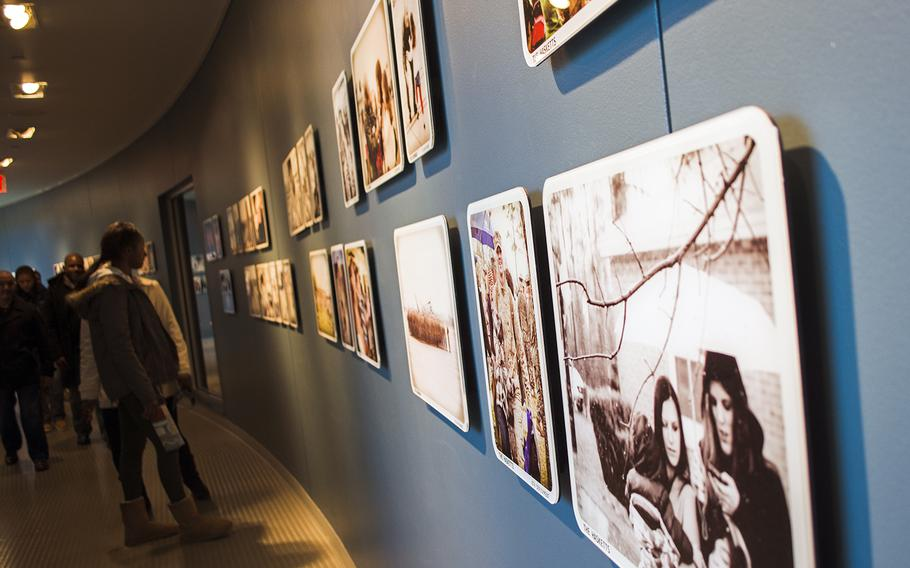 """A temporary exhibit at the National Museum of the Marine Crops, the """"Welcome Home"""" collection is a series of photographs and memorabilia that is meant to capture """"the reunions of family members who have been separated by repeated deployments."""" The exhibit will be on display through 2016."""