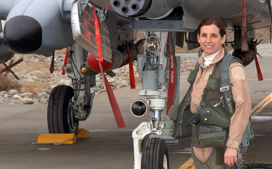 Lt. Col. Martha McSally stands with her A-10 Thunderbolt II aircraft. McSally was the first female pilot in the Air Force to fly in combat and to serve as a squadron commander of a combat aviation squadron.