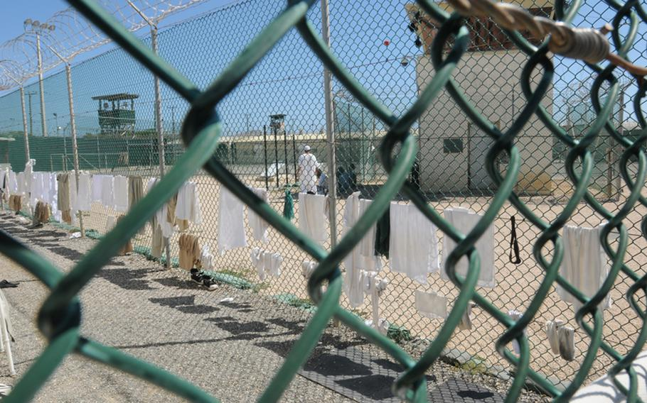 Detainees' laundry hangs to dry on a fence at  Joint Task Force Guantanamo Bay, Cuba, in October 2010.