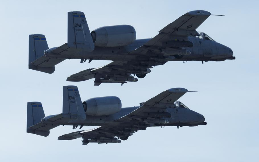 Two U.S. Air Force A-10 Thunderbolt II aircraft assigned to the 354th Expeditionary Fighter Squadron take off from a runway during deployment at Campia Turzii, Romania, April 14, 2015.
