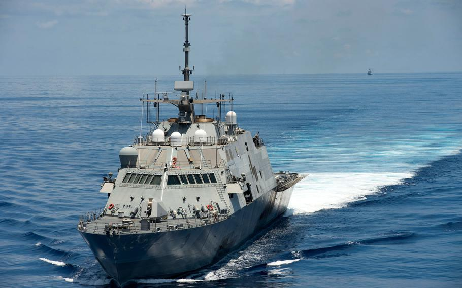 The littoral combat ship USS Fort Worth patrols in international waters of the South China Sea near the Spratly Islands as the Chinese guided-missile frigate Yancheng follows in the distance on Monday, May 11, 2015.