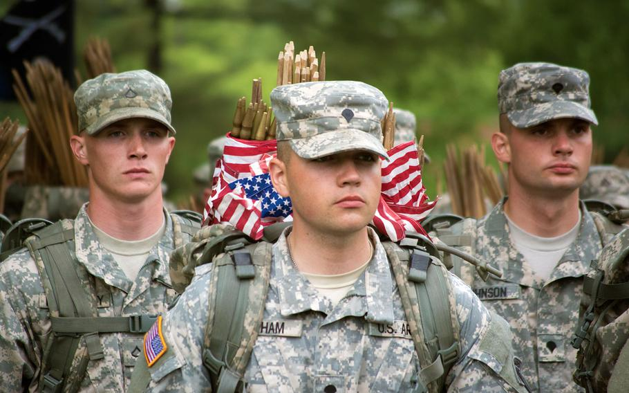 Members of The Old Guard march into Arlington National Cemetery at the start of Flags-In on Thursday, May 21, 2015, in Arlington, Va.