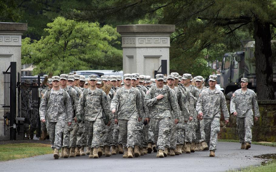 Members of The Old Guard march into Arlington National Cemetery at the start of Flags-In on May 21, 2015.