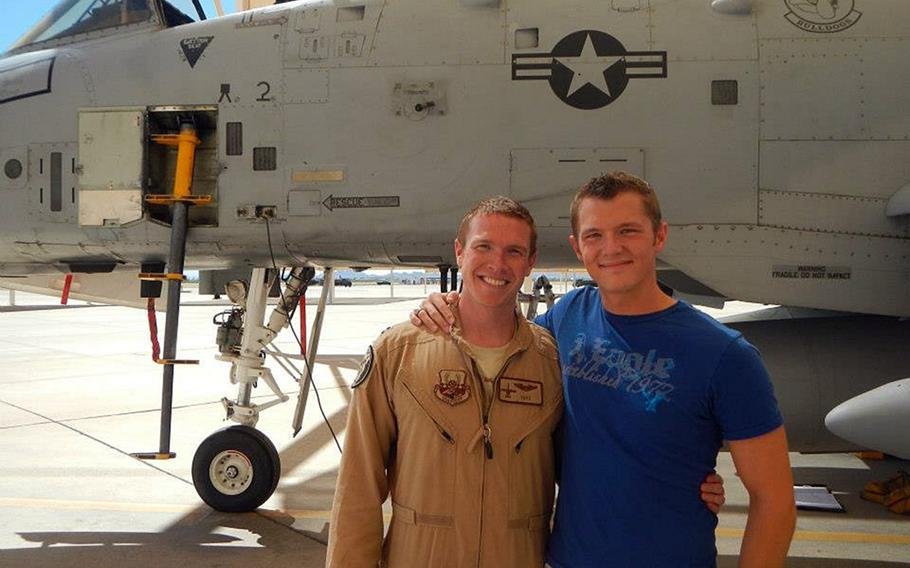 Former Air Force officer Tyler Haugseth, right, stands with his husband, Capt. Brent Cox. Haugseth, who lives with Cox in San Antonio, said the recent Supreme Court decision legalizing same-sex marriage across the U.S. was a win for gay servicemembers but left unanswered questions about adoption and parental rights.
