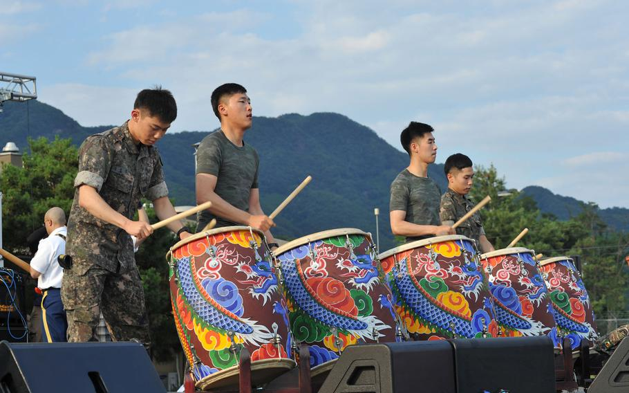 A group of drummers entertains servicemembers and their families at the Camp Casey Independence Day celebration and Salute to the Nation Ceremony.