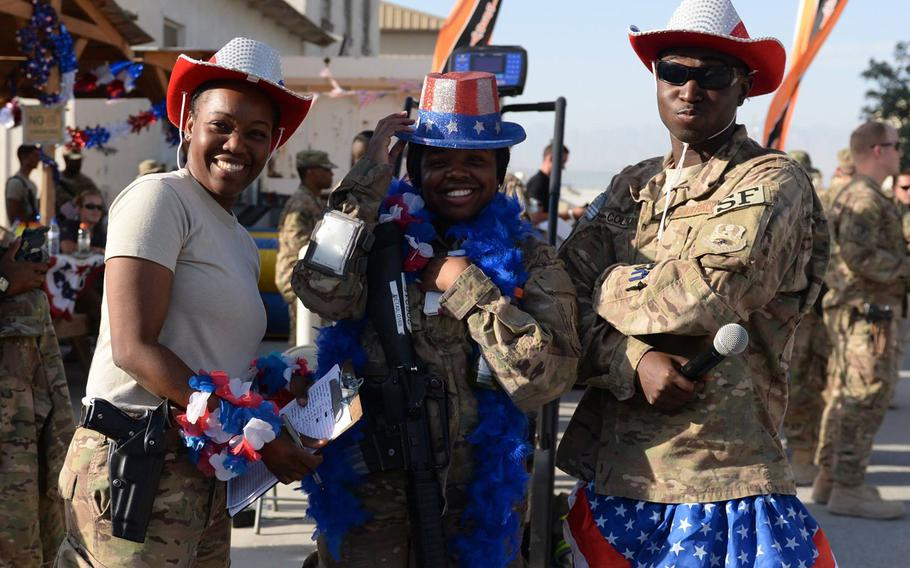 Volunteers pose for a photo during an Independence Day block party July 3, 2015, at Bagram Airfield, Afghanistan. The celebration, which was hosted by the 455th Expeditionary Force Support Squadron, included games, food and a firefighter challenge.